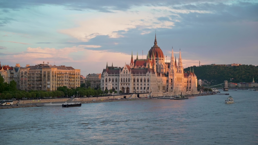 Budapest, Hungary across the Danube River at sunset. | Shutterstock HD Video #1036710890