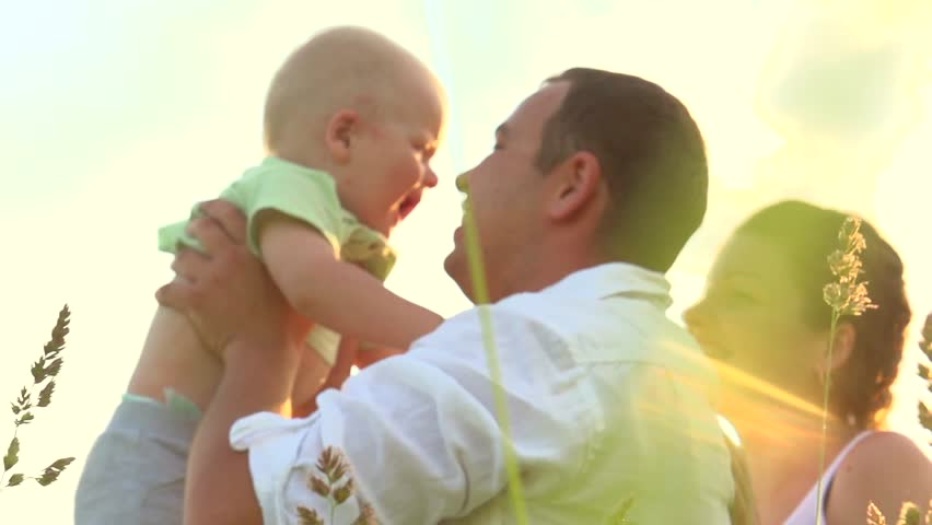 Happy family with little baby outdoors. Mother, Father and Baby having fun Together in Green Summer Park. Mom, Dad and Child. Happy smiling Family enjoying nature. Slow motion 1080p. High speed camera | Shutterstock HD Video #10368950