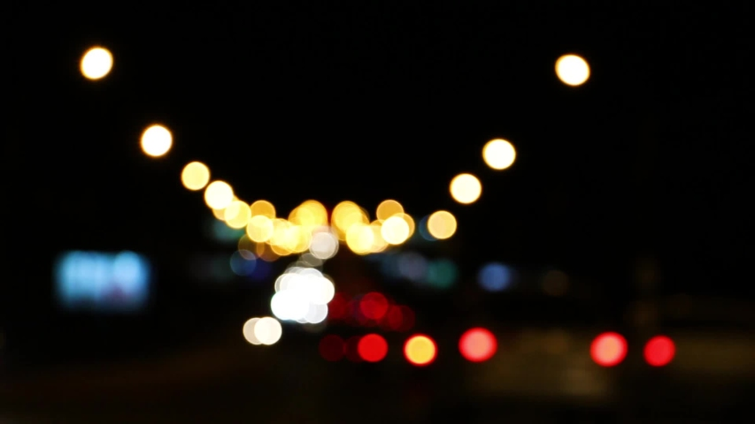 Blurred car lights at the crossroads of the big night city   Shutterstock HD Video #1036901210
