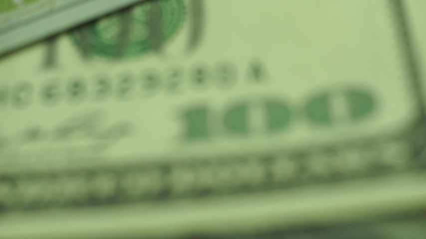 Close up Beautiful Dollars Background. American, US Dollars Cash Money. One Hundred Dollar Banknotes. Macro view. Rotation 360 degrees | Shutterstock HD Video #1036933970