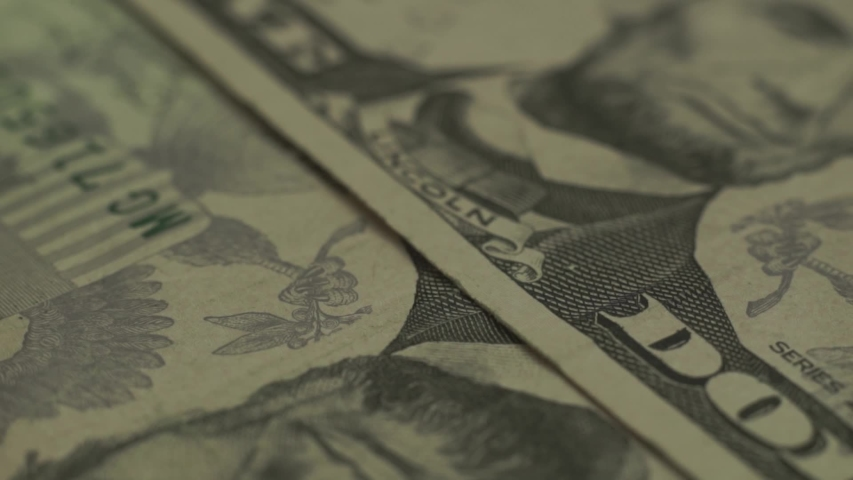 Lincoln's face in close up on a five dollar background. Macro view. Rotation 360 degrees. | Shutterstock HD Video #1036934990