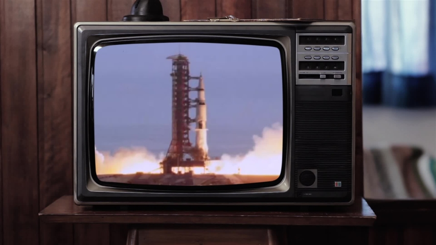 Apollo 11 Rocket Launch in an Old Vintage TV. Blue Dark Tone. Elements of this Image Furnished by NASA.  | Shutterstock HD Video #1037144120