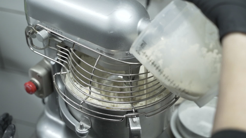 Chef adding liquid to mixing machine in restaurant kitchen. Close up slow motion. | Shutterstock HD Video #1037154530