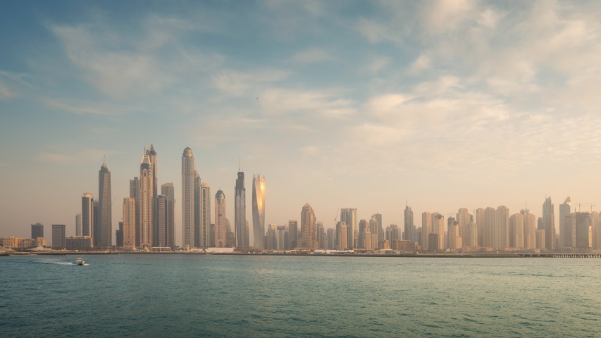 Timelapse of skyscrapers in Dubai Marina, sunset time, UAE | Shutterstock HD Video #1037248310