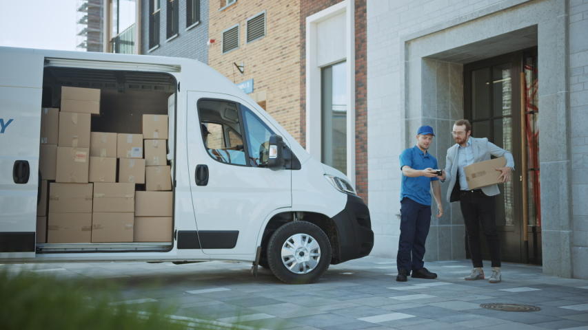 Courier Gets out of Delivery Van, Takes out Postal Package and Man Gives it to a Customer, Who Signs Electronic Signature POD Device. In Business District Courier Delivers Cardboard Box Parcel to Man | Shutterstock HD Video #1037351240
