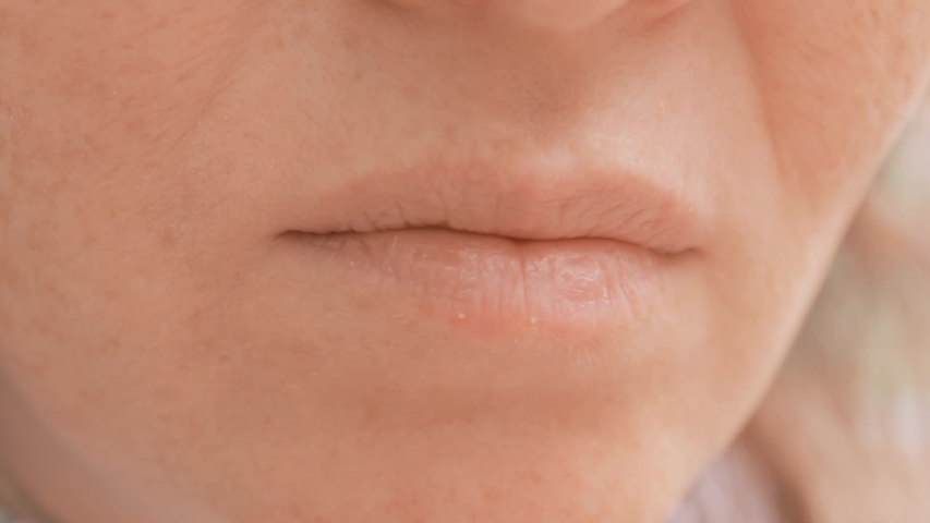 Woman mouth close up. Eating food outside in a park. Fingers bring sweet popcorn to your mouth. | Shutterstock HD Video #1037355050