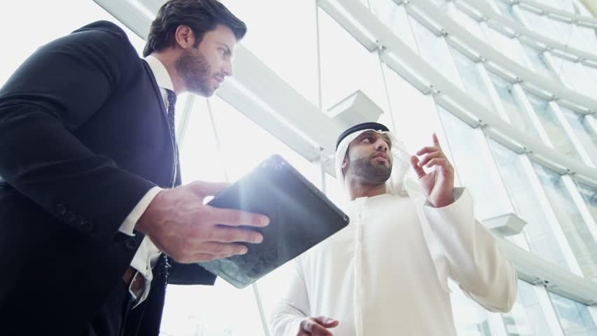 Handshake Middle Eastern American business male tablet real estate development