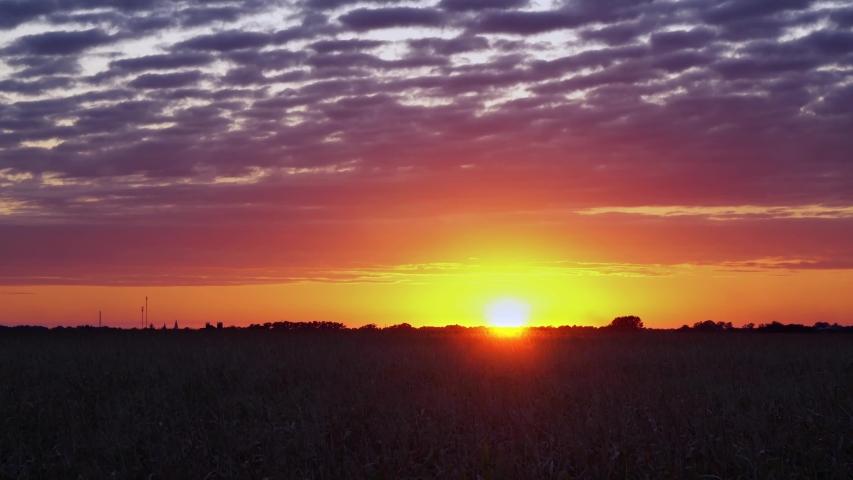 SERIES Red orange sunset sky orange video 4k cloud Red orange cloudscape background Dark red purple sunset sky cloud 4k