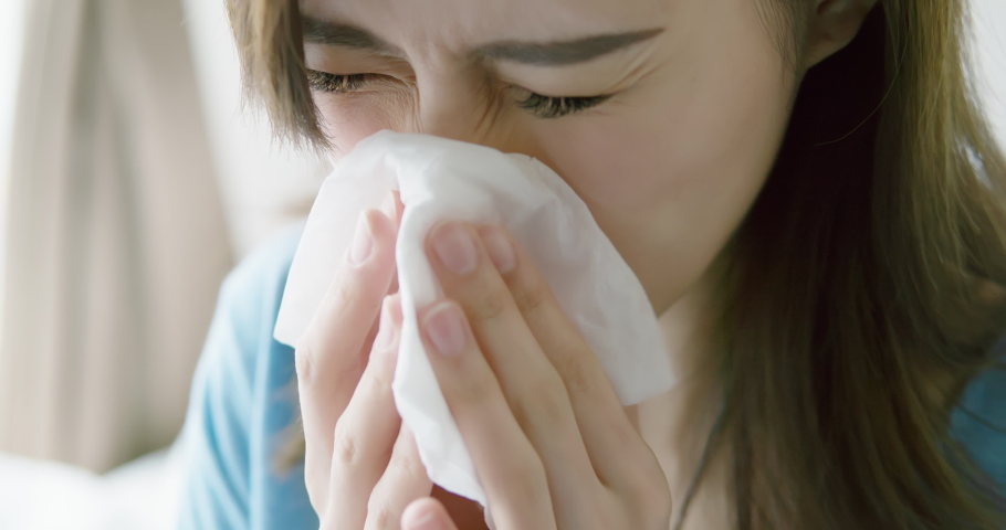 Slow motion and closeup of asian woman sick and sneeze with tissue paper in the bedroom | Shutterstock HD Video #1037461880