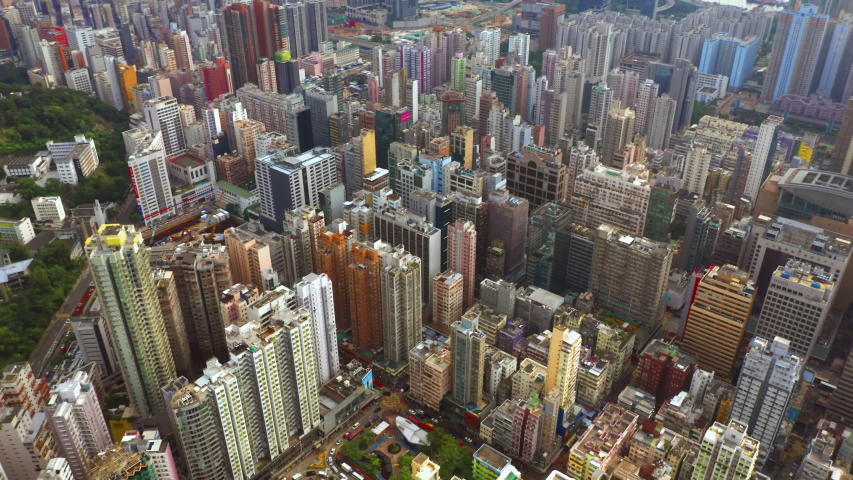 Aerial top view of Hong Kong Downtown, republic of china. Financial district and business centers in smart urban city in Asia. Skyscrapers and high-rise modern buildings. | Shutterstock HD Video #1037744300