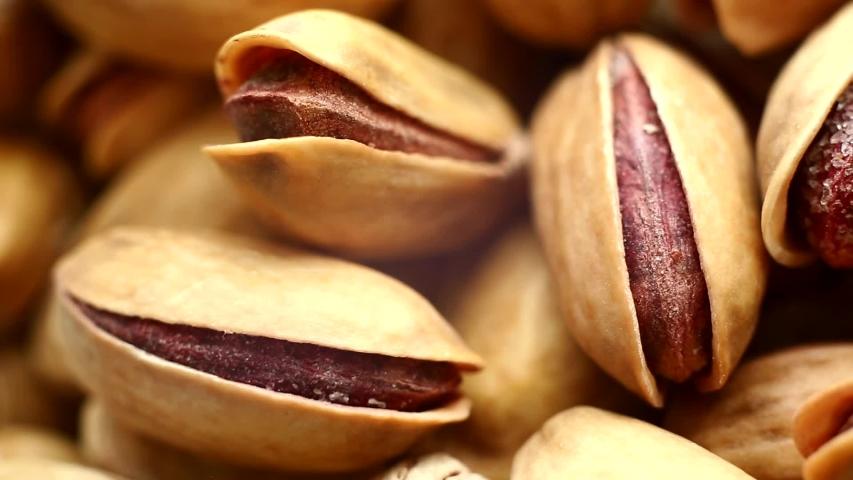 Roasted pistachios close-up. Pistachio nut with salt. macro | Shutterstock HD Video #1037794880