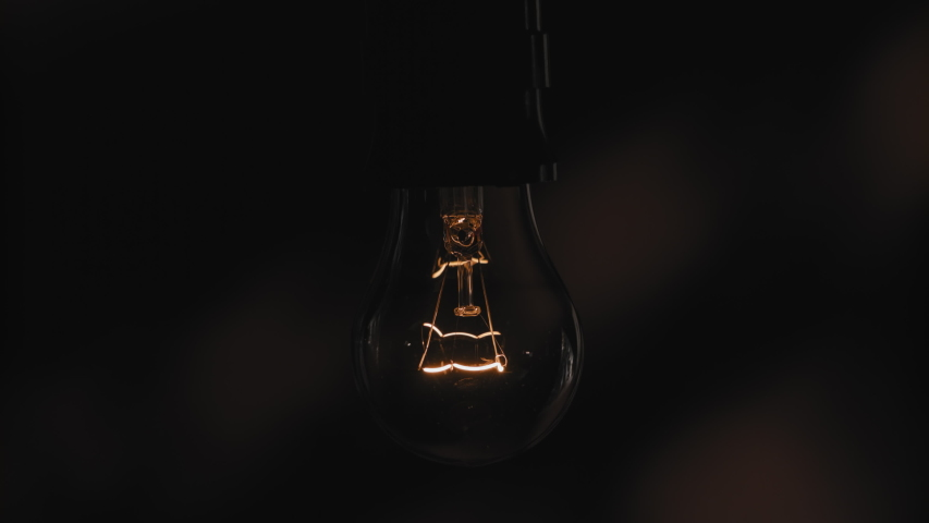 Light bulb Turns On and Off. Close Up.4K   Shutterstock HD Video #1037980010