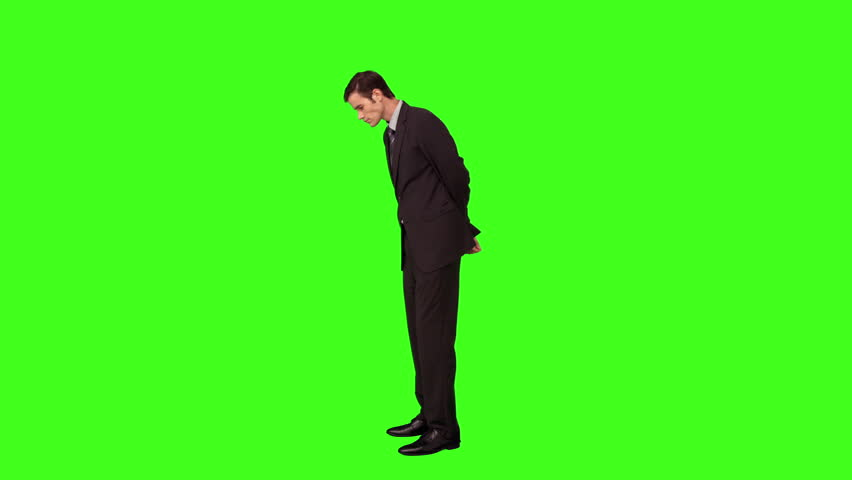 Businessman standing and looking down on green screen background   Shutterstock HD Video #10380050
