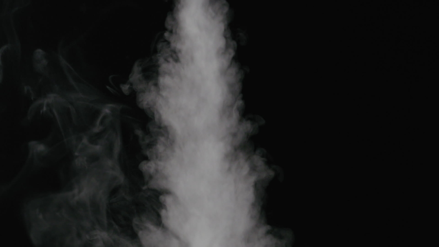 Slow motion water mist stream over black background #1038018350