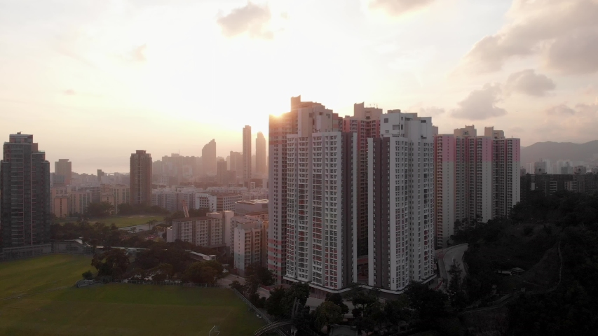 Apartment buildings in Hong Kong. Aerial view during sunset.  | Shutterstock HD Video #1038038450