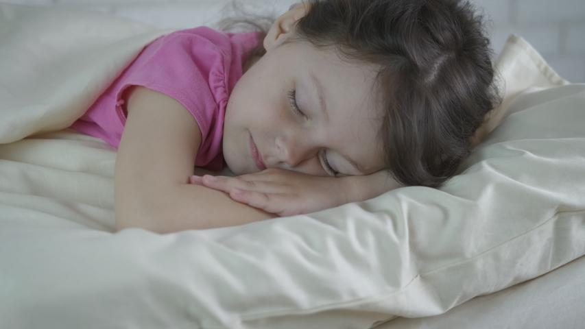 Sleeping cute child. Portrait of a sleeping beautiful little girl.   Shutterstock HD Video #1038053990