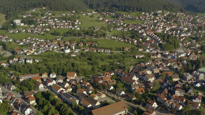 Aerial view of the city Baiersbronn in Germany in the black forest on a sunny day in summer. Wide view with zoom out. | Shutterstock HD Video #1038287660