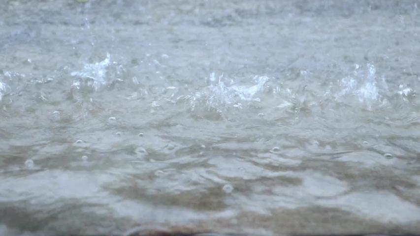 The Heavy rain drops on concrete floor | Shutterstock HD Video #1038793970
