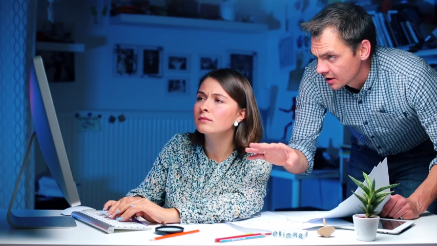 Manager discusses annual income and taxes with an accountant, shows like   Shutterstock HD Video #1038899690