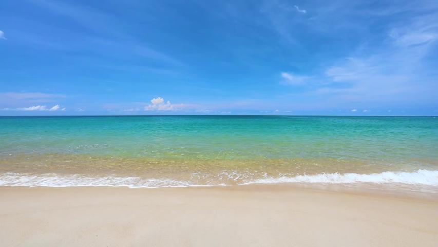 Phuket tropical beach on high season in Thailand. The waves on sand beach and beautiful sky. | Shutterstock HD Video #1038906680