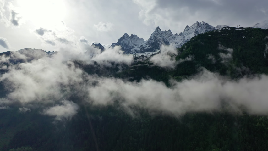 Aerial: Beautiful Snowy Mountain Peaks Over the Clouds - Chamonix, France | Shutterstock HD Video #1038924350