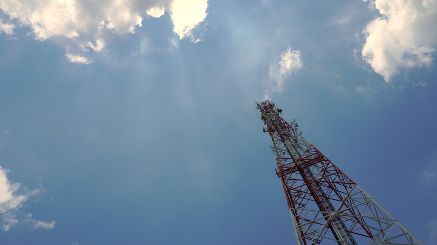 Time Lapse Signal tower or Mobile phone tower with dayligth sky and white cloud. Telecommunication tower Antenna.Modern communication concept by using 5 g internet  | Shutterstock HD Video #1038974480