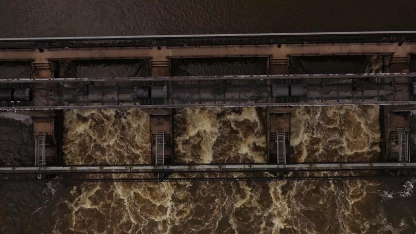 Overhead drone rising shot Colwick Sluice engineering innovation lock and dam flood gates Nottingham UK | Shutterstock HD Video #1039006910