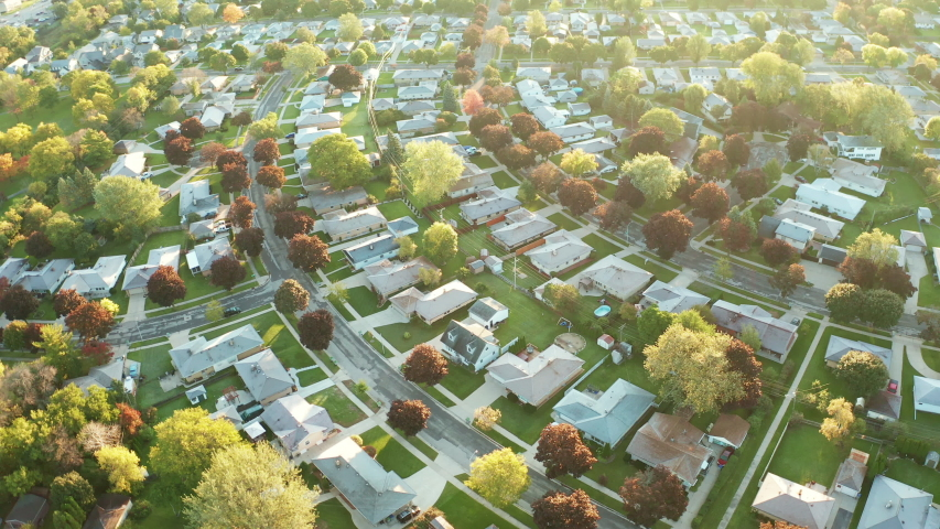 Aerial view of residential houses at autumn (october). American neighborhood, suburb. Real estate, drone shots, sunset, sunny morning,  sunlight, from above | Shutterstock HD Video #1039007930