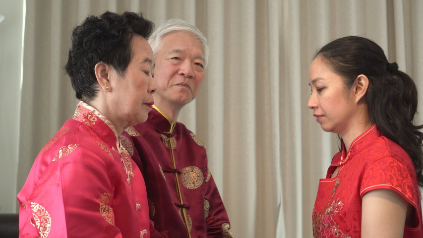 Asian parents give daughter in law thumb up Chinese New Year | Shutterstock HD Video #1039107590