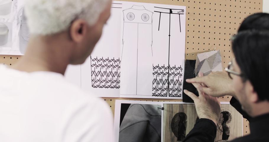 Fashion designers choosing fabrics together | Shutterstock HD Video #1039186010