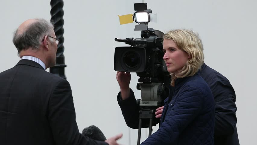 London May 7th 2015. The UK is having a general election and television news reporters are on location covering events.    Shutterstock HD Video #10393736