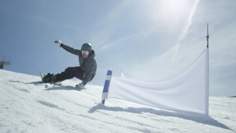 SLOW MOTION: Professional snowboarder at slalom training in ski resort