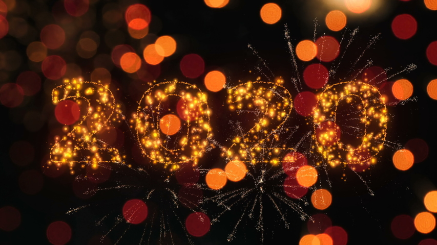 Happy new year 2020 sparkling year lettering with fireworks particles background. Merry Christmas and Happy New Year background.