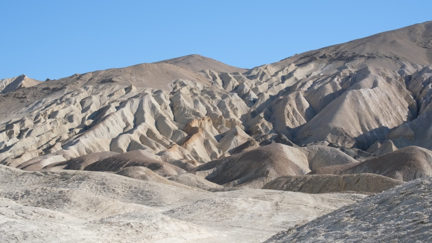Rocky hills, gullies and canyons in Death Valley, California Desert - Zabriskie Point | Shutterstock HD Video #1039803590