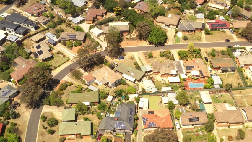 Aerial view of streets, cul-de-sacs, rooftops and parklands in the suburb of Latham in Canberra, the Capital of Australia      | Shutterstock HD Video #1039823510