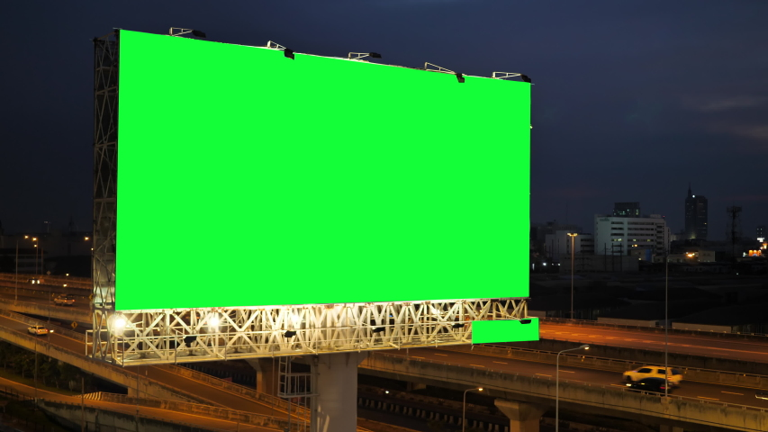 Green screen of advertising billboard on expressway during the twilight with city background in Bangkok, Thailand. | Shutterstock HD Video #1039953740