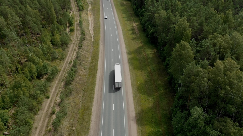 Aerial Top View of White Truck with Cargo Semi Trailer Moving on Road in Direction f Loading Warehouse Area. | Shutterstock HD Video #1040388560
