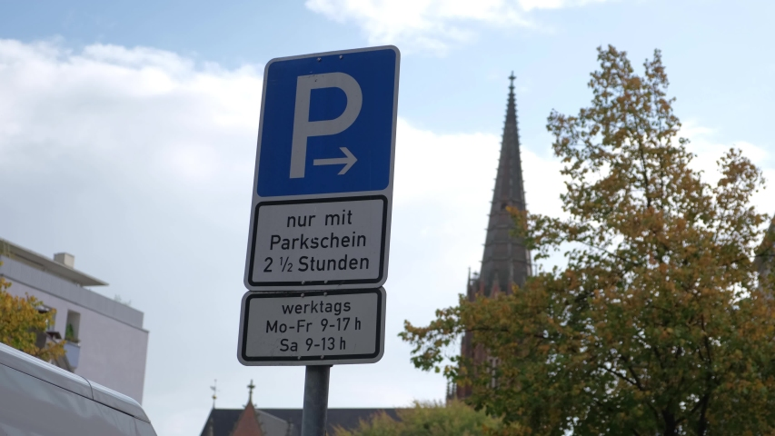 Hamburg / Germany-10.02.2019: blue road sign on the background of the Catholic Cathedral.   Shutterstock HD Video #1040494190