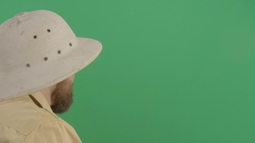 Adult Man Explorer Watching Through Binoculars To The Green Screen . Studio Isolated Shot Against Green Screen Background | Shutterstock HD Video #1040503430