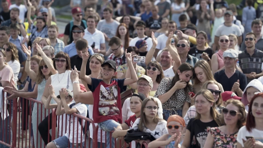 England - Bristol, 07.212019: audience at the event looking at something on a summer sunny day. Action. Many spectators standing in the city square. | Shutterstock HD Video #1040614100