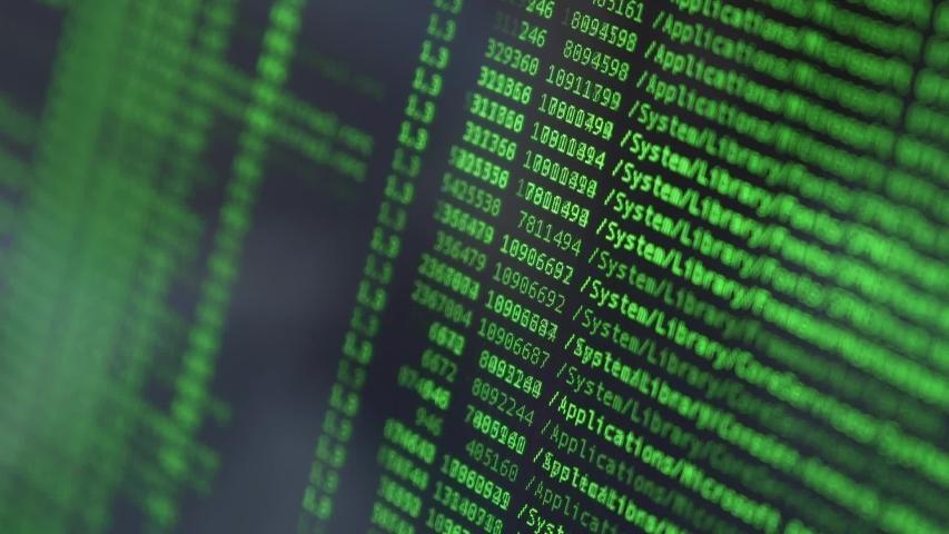 Hexadecimal code running up a computer screen. Green-ish digits. Close-up shot. Shallow depth of field. | Shutterstock HD Video #1040618510
