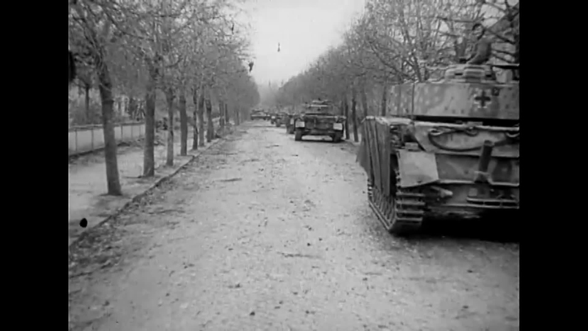 CIRCA 1940s - German tanks roll through Goldap, Poland after securing the city during World War 2 in this propaganda film