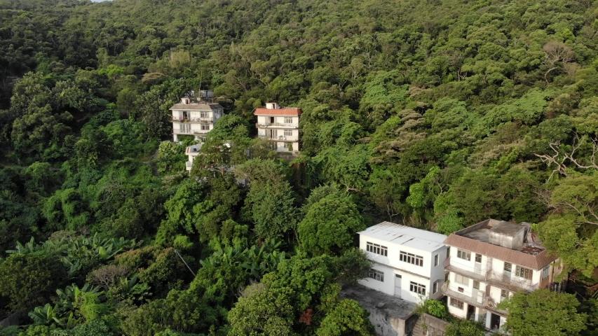 Aerial view a few villas among a lot of greenery. Lamma island, Hong Kong   Shutterstock HD Video #1040818940
