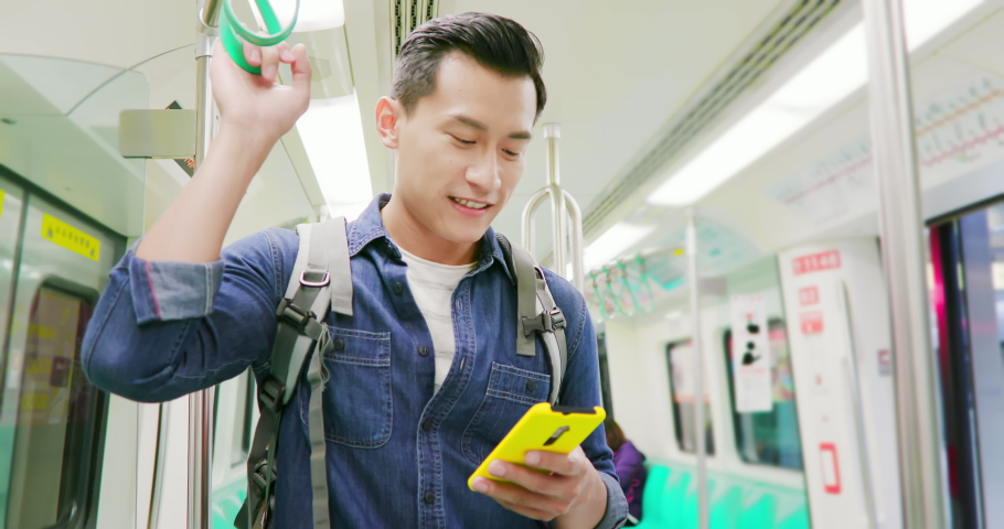 Close up of asian young man use 5g smartphone on the mrt or train | Shutterstock HD Video #1040827280