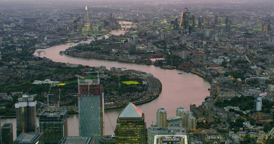 Aerial view of London's famous landmarks.The city financial district with its modern skyscrapers. Famous bridges and buildings. Thames River. England. UK. | Shutterstock HD Video #1040869250