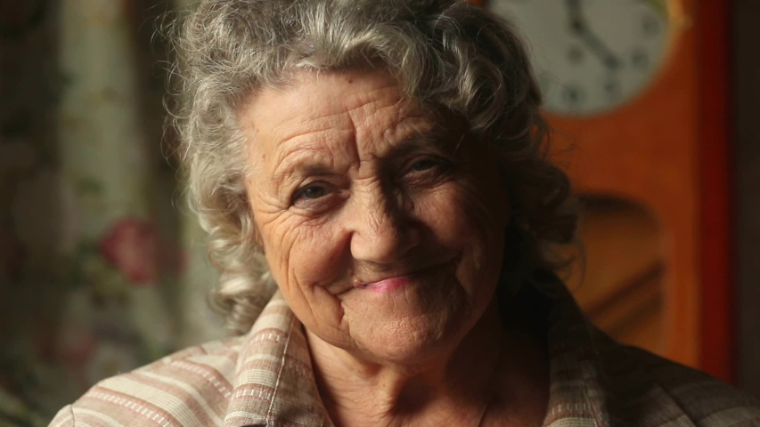 Smile and happy elderly woman face slow motion | Shutterstock HD Video #1040962550