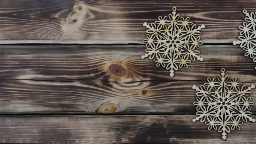 Three wooden snowflakes on timber back | Shutterstock HD Video #1041092320