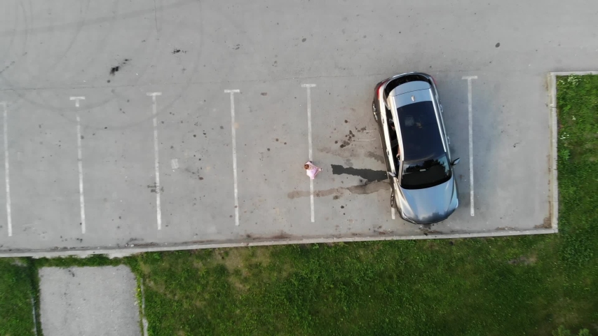 Aerial drone shot of young handsome casual businessman uses smartphone in the city | Shutterstock HD Video #1041106000