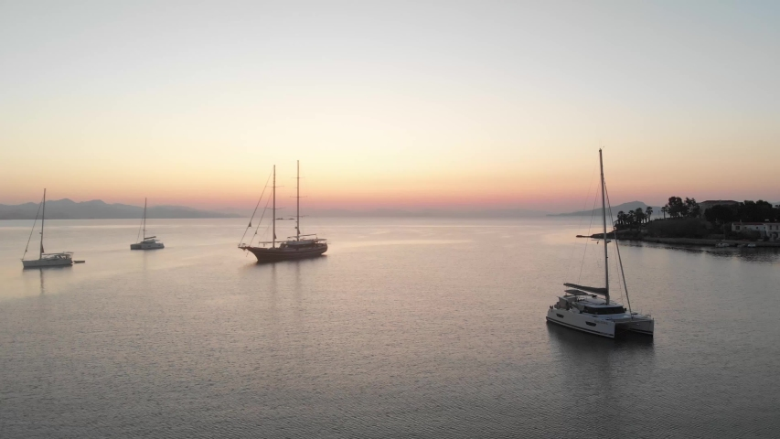 Anchored sailing ships in Datca harbor and a great sunrise. Aerial shots | Shutterstock HD Video #1041417430