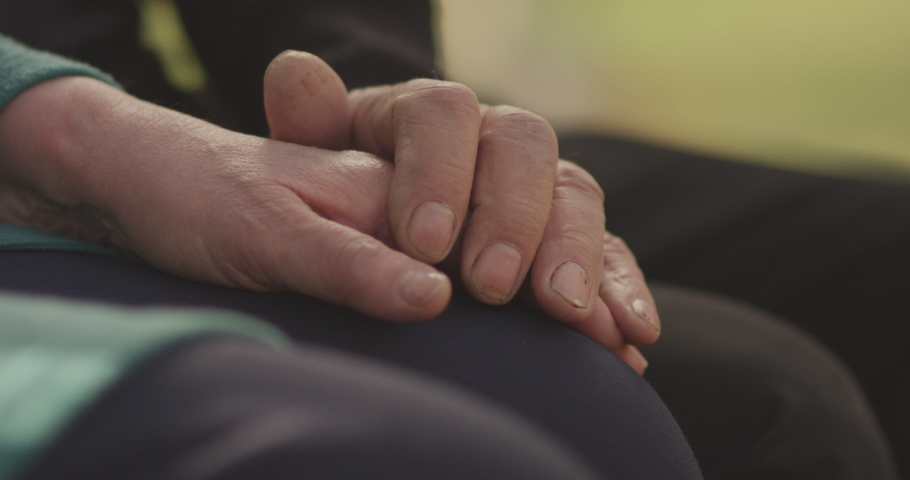 4K Faithful old couple holding hands. Close-up of hands of lovely aged couple caring and loving each other. Support trust in marriage relationship. Beautiful footage. Health care concept. Slow Motion. | Shutterstock HD Video #1041447820